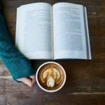 Holding hot beverage whilst reading book